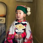 Kid wearing Himachali dress and kinnauri topi